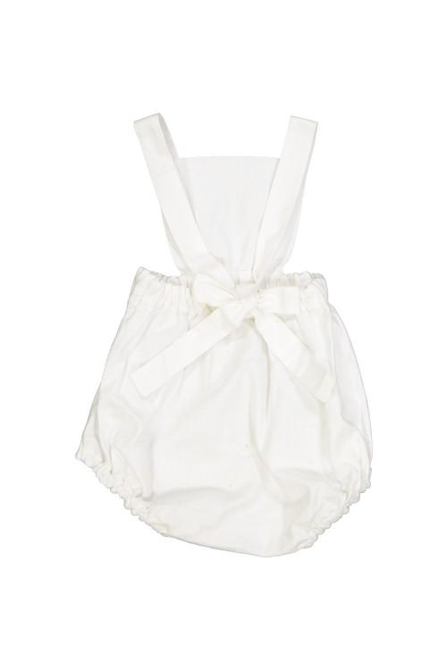 combinaison bébé toile blanche à bretelles